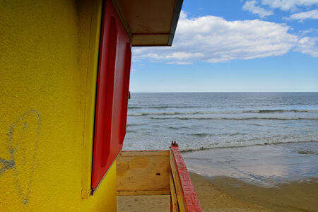 Yellow beach house overlooking the surf