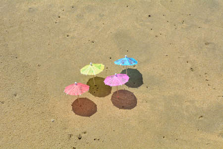 Party umbrellas on the beach.