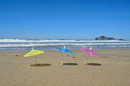 3 Party umbrellas on the beach. Stockfoto