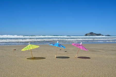 3 Party umbrellas on the beach. Stock Photo