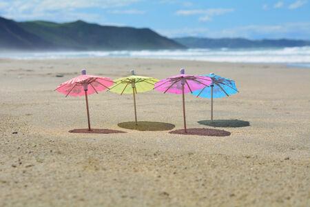 Party umbrellas on the beach.