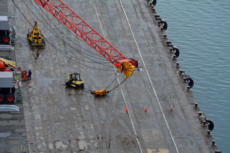 Aerial view of a crane wheel being fixed