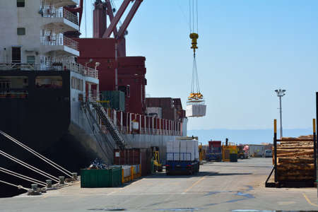 Dock activity and loading of a cargo ship