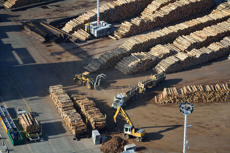 Aerial view of moving logs at a port
