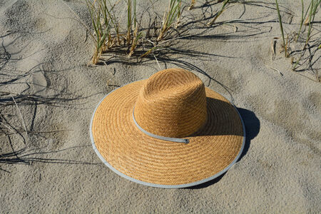 Hat laying in the sand on a beach