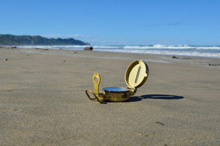 Compass on a beach in New Zealand