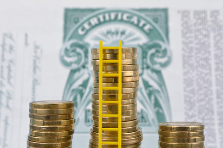 Money on old stock certificates. Stockfoto