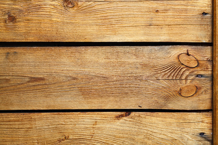 ochre: Textured background of ochre painted wooden boards