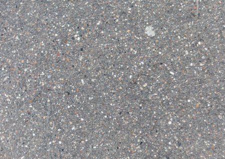 Asphalt texture. Asphalt road. Pattern with small elements. Gray pattern.