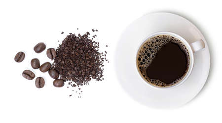 Closeup ceramics cup of hot black coffee and instant granular coffee with coffee beans isolated on white background. Top view. Flat lay