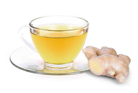 Closeup hot ginger tea in glass cup with fresh organic ginger root isolated on white background .