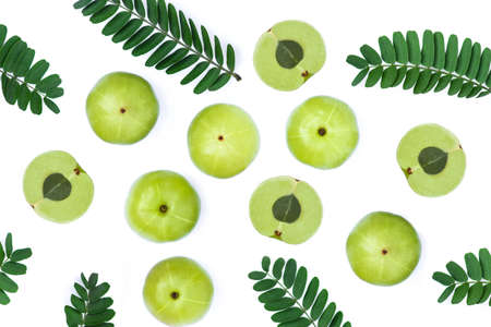 Set of Indian gooseberry fruits ( Amla,  phyllanthus emblica ) with green leaves isolated on white background. Top view. Flat lay. 版權商用圖片