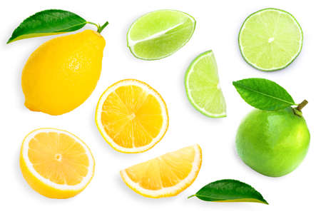 Whole and slice of green lime and yellow lemon on white background. Top view. Flat lay.