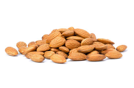 Heap of almond nuts isolated on white background. Standard-Bild