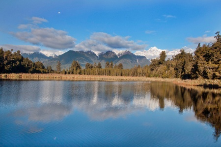 Reflection of Mount Cook and Tasman in Lake Matheson  photo