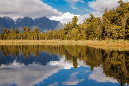 The reflection of Mount Cook and Tasman in the lake Matheson photo