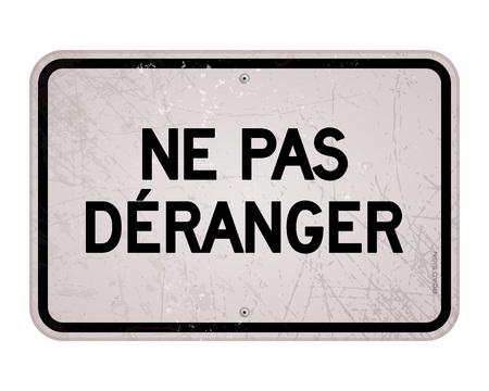 Rectangular black and white do not disturb sign in large bold black text as ne pas deranger