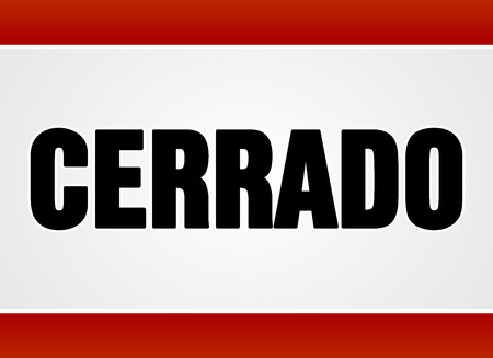 shut out: Single closed sign in large bold black text over white and red as cerrado in Spanish