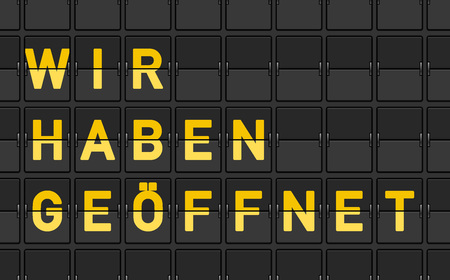 Close up of black panel flip sign with yellow letters reading wir haben geoffnet Ilustração
