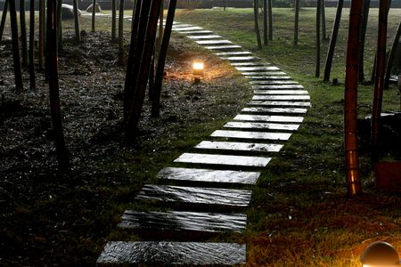 garden lamp: The wet stone road in garden after rain in night. Stock Photo