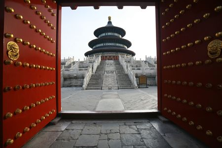 Old gate is opening in The Temple of Heaven in Beijing. Stock Photo