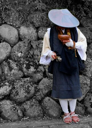pilgrim costume: Buddhist monk collecting fund for the temple in a  Japanese street.