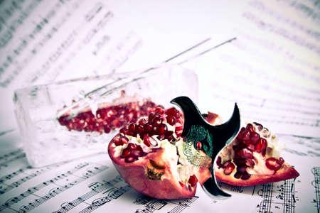 shuriken: Red pomegranate pierced by shuriken on the music partiture sheets