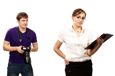 Photographer and a young attractive serious businesswoman photo