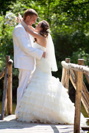 Wedding - happy bride and groom kissing
