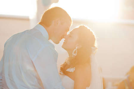 Wedding - happy bride and groom kissing Stock Photo - 12359107