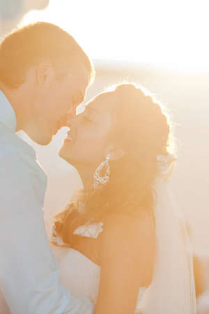 bridal veil: Wedding - happy bride and groom kissing