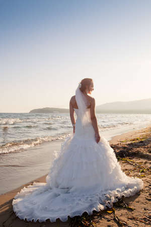 Bride at the beach Stock Photo
