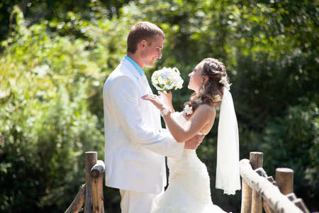 bridal couple: Happy bride and groom smiling and huggling Stock Photo