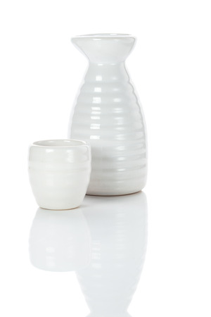 white porcelain traditional japanese jug and shot of sake, isolated with clipping path Stock Photo