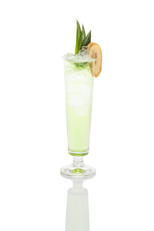 cold green cocktail in a misted over footed highball glass with cubed ice and banana slice, isolated with clipping path