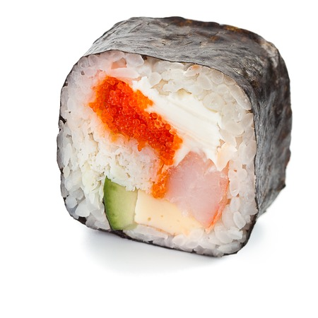 Traditional japanese futomaki roll stuffed with tobiko caviar, cream cheese, tomago omelet, cucumber, crab meat and shrimp