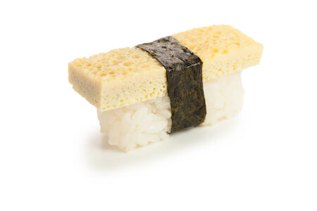 single served tomago nigiri sushi made of traditional japanese omelet - isolated