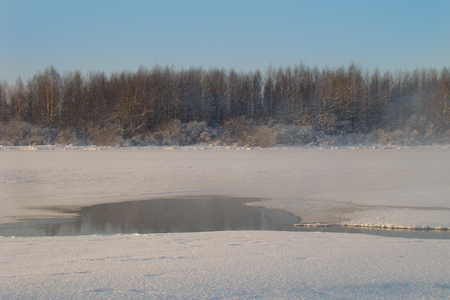warm water: fog over the clearing of warm water in winter