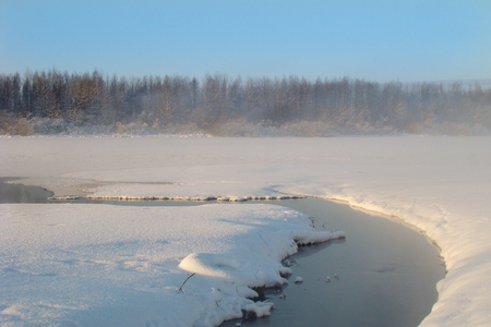 warm water: fog over a stream of warm water in winter