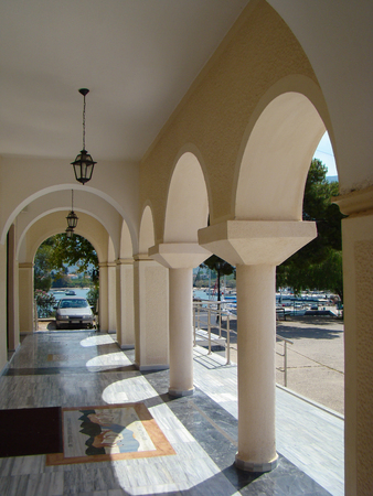 architectural lighting design: arched architectural elements in a row and lights in the house