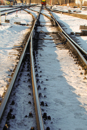 turnouts: rails in the sun in the snow with turnouts