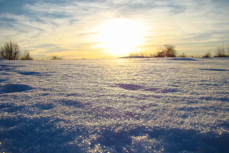 powdery: sunlight along the field covered with powdery snow Stock Photo