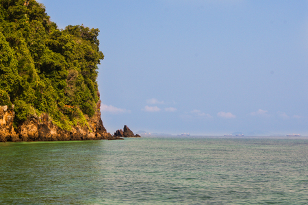 no body: high rocky island covered with lush green trees