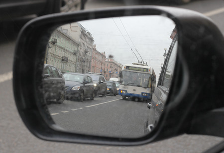 no body: reflection of urban stream of cars in the mirror