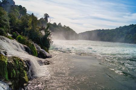breakers: water mist over the water foaming breakers