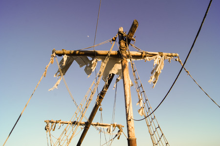 no body: Mast of the old ship with torn sails