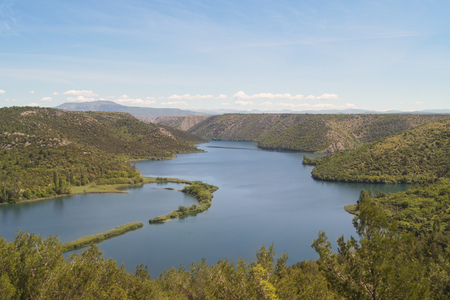 body curve: Sinuous lake between green hills are not high Stock Photo