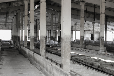 abandoned room: Abandoned room ranching complex with concrete pillars Stock Photo