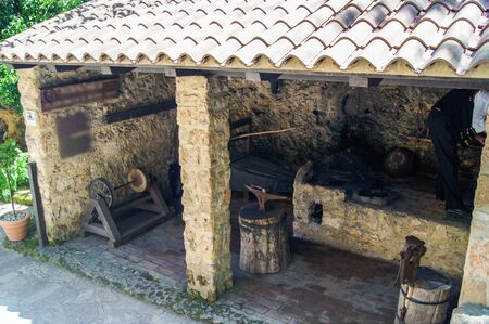 smithy: small smithy with tools and devices under the roof