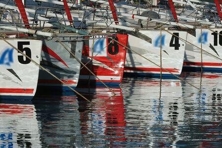 berth: ships at berth on the shiny surface of the water
